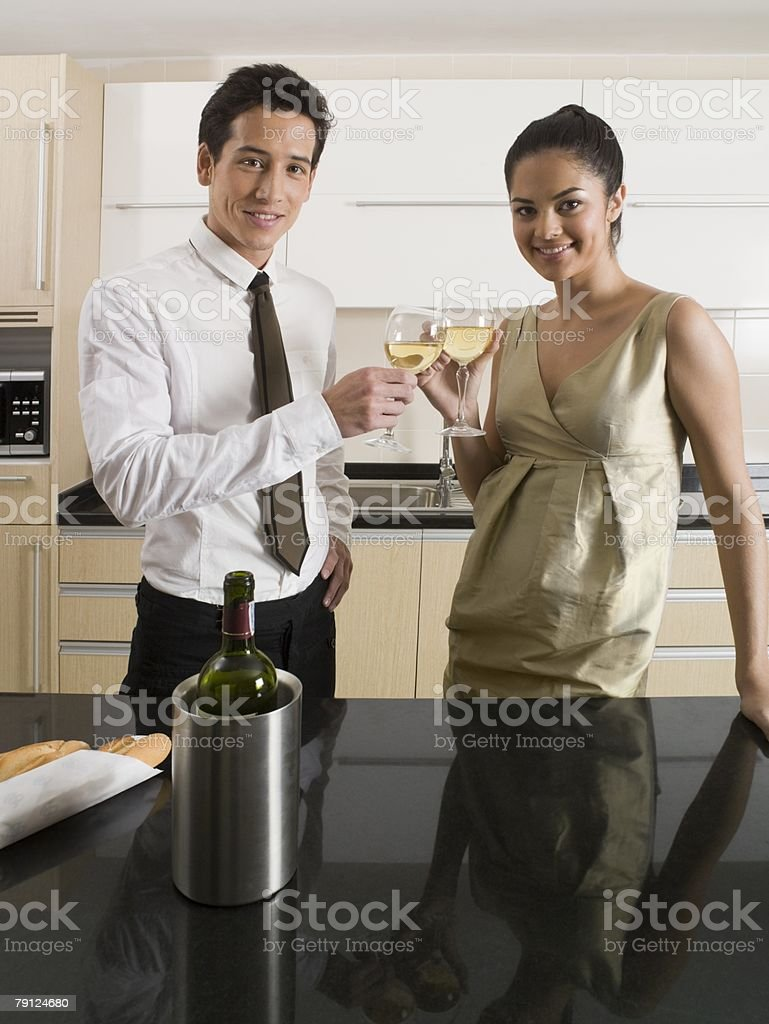 Couple toasting with wine royalty-free stock photo