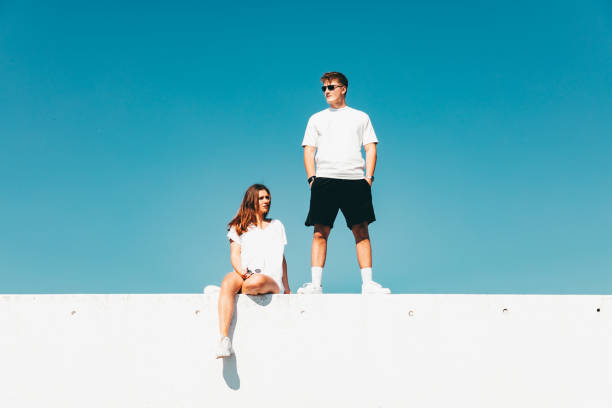 Couple Together Concrete Wall Modern Urban Lifestyle stock photo
