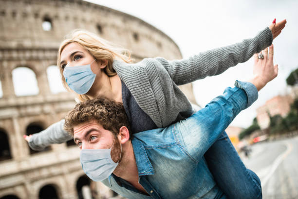 couple together in rome during the covid19 stock photo