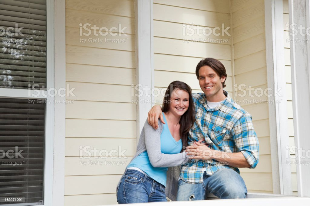 Couple together on porch stock photo