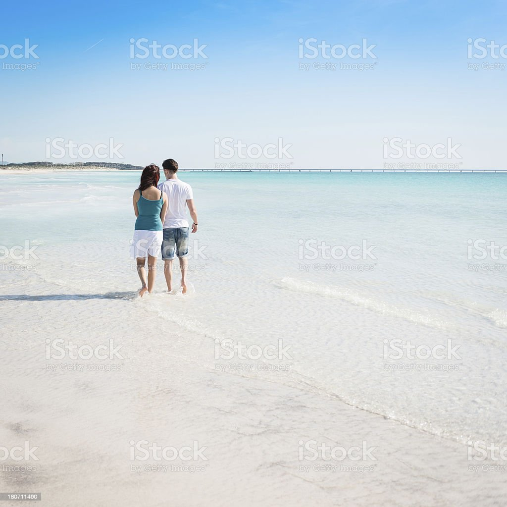 Couple togetherness walking on the beach royalty-free stock photo