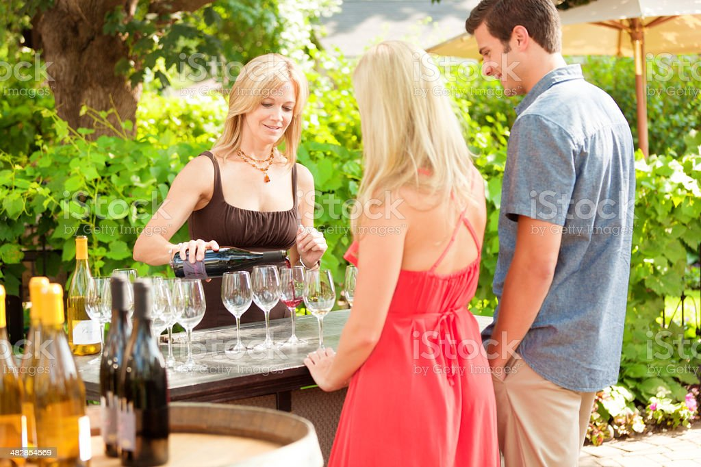 Couple Toruing Winery Attending Wine Tasting stock photo