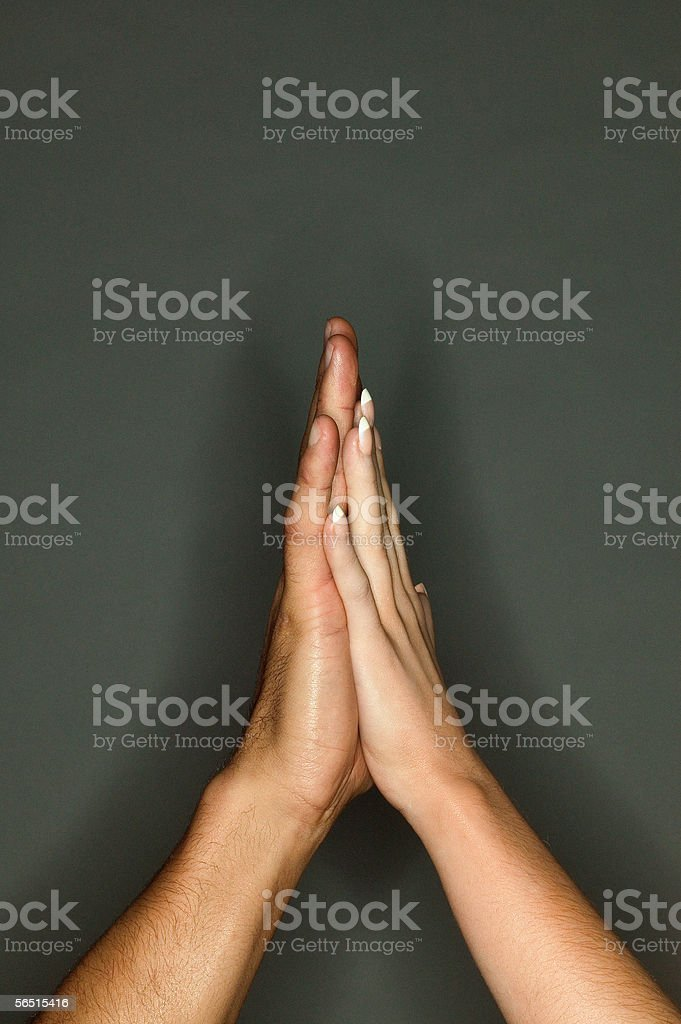 Couple touching hands stock photo