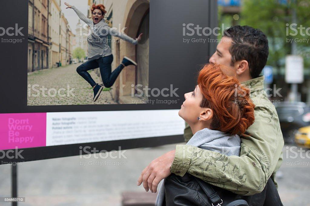 Couple tourist looking street exhibition