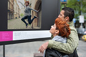 Couple tourist looking downtown contemporary street exhibition at leisure time