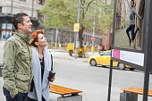 Couple tourist looking street exhibition