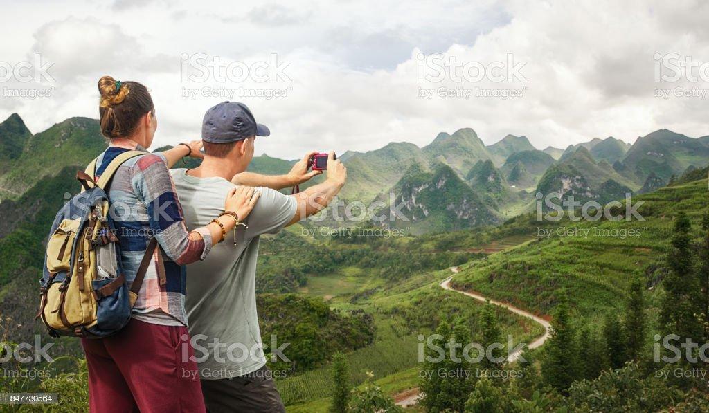 Couple tourist makes photo karst mountains. stock photo
