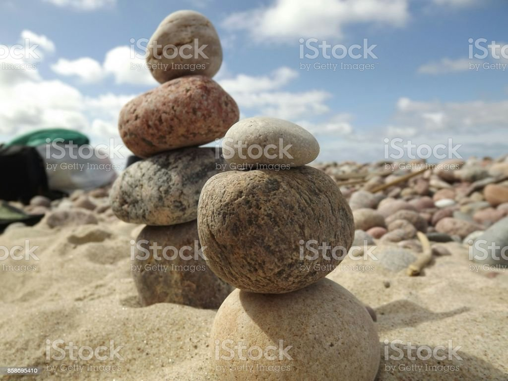 Couple  towers of stones in the beach stock photo