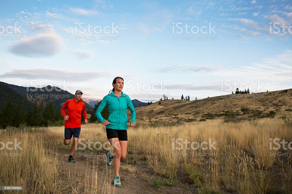 Couple Trail Running in The Mountains of Western U.S. royalty-free stock photo