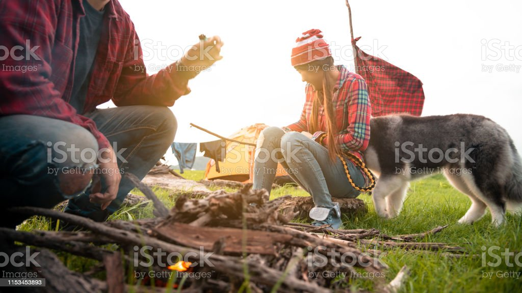 Couple travel camping in countryside with campfire, Great warm...