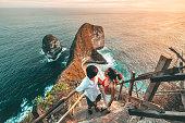 Couple Travel view of landscape with Kelingking beach, Nusa Penida island Bali ,Indonesia
