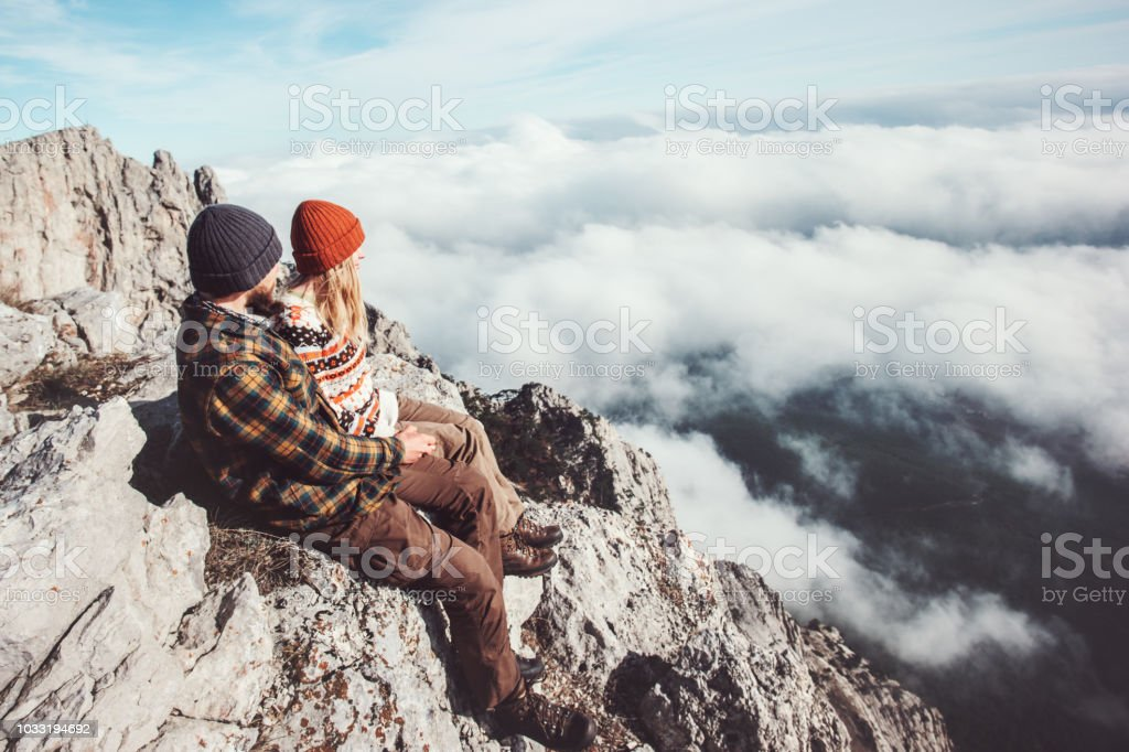 38261fbd99e Couple travelers Man and Woman sitting on rocks relaxing mountains and  clouds landscape Love and Travel happy emotions Lifestyle concept. Young  family ...