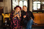 Happy beautiful tourist couple waiting train on Orient Express railway station in Istanbul Travel to turkey