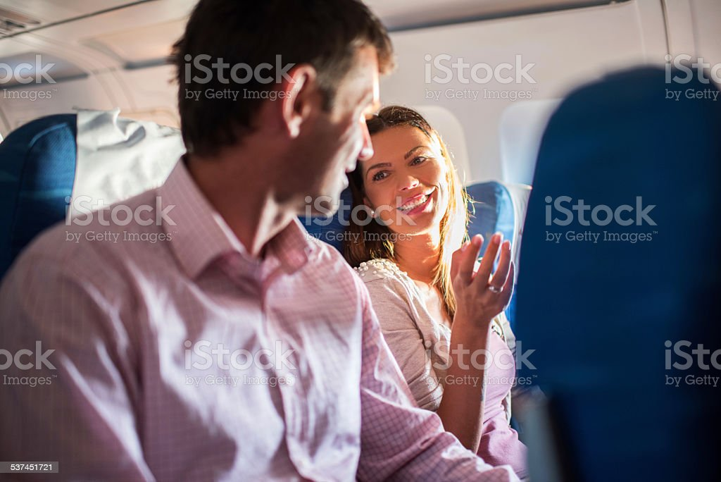 Couple traveling by airplane. stock photo