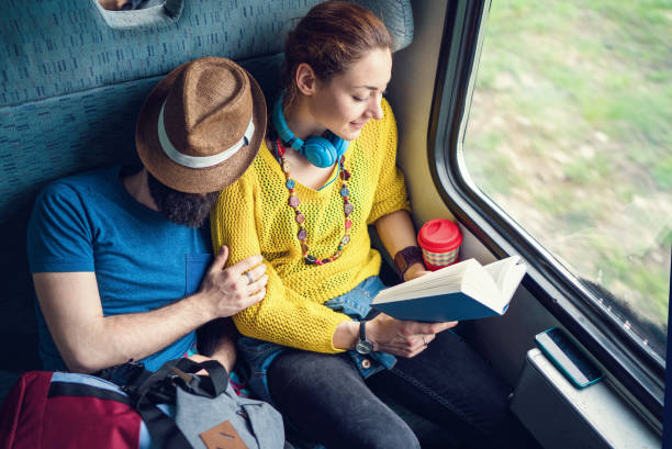 Couple traveling by train stock photo