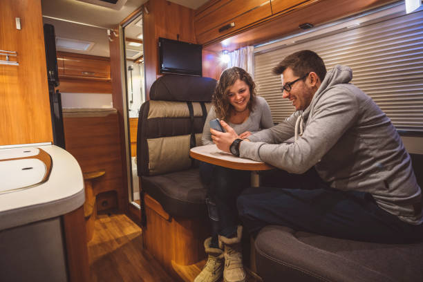 Couple traveling with a caravan Couple traveling with a caravan rv interior stock pictures, royalty-free photos & images