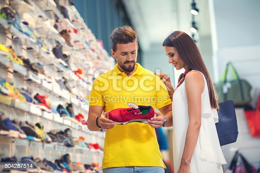 istock Couple trying items in the sport shop 804287514