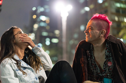 Couple Two Friends Having Fun In The City At Night Stock