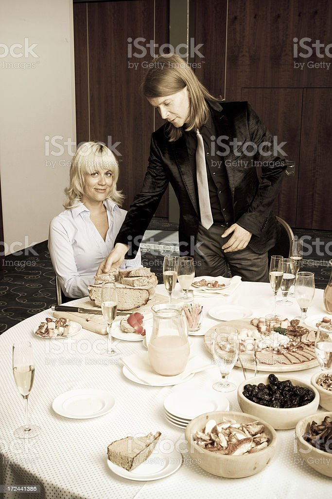 Couple under the big table with food royalty-free stock photo