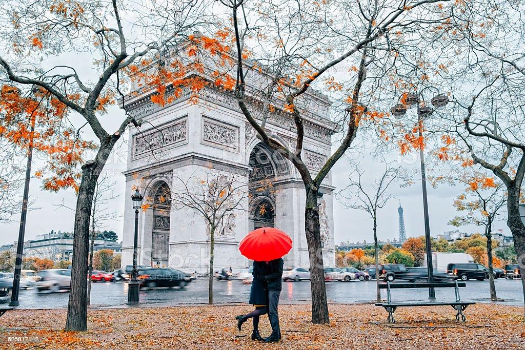 Couple under umbrella at rain in Paris stock photo