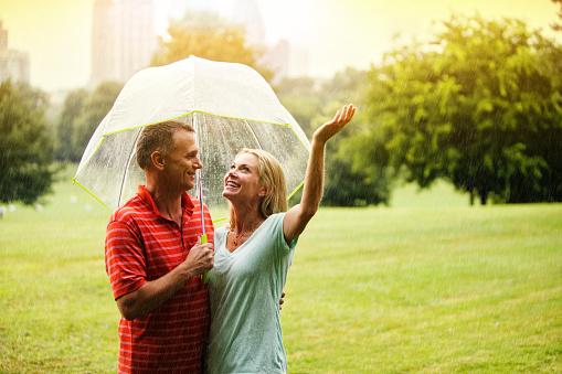 Couple under umbrella in the Park in Atlanta, Ga