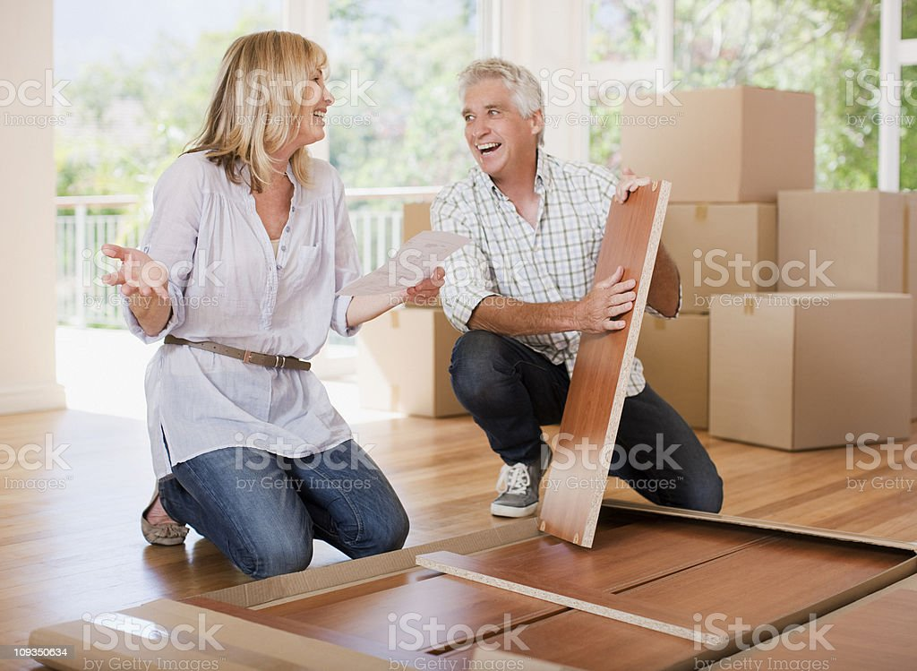 Couple unpacking boxes in new house royalty-free stock photo
