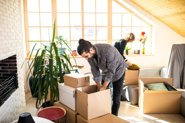 couple unpacking boxes together - being in a relationship with someone is going to require stock photos and pictures