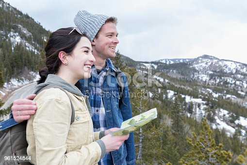 483422527istockphoto Couple use trail map while on hike 961524844