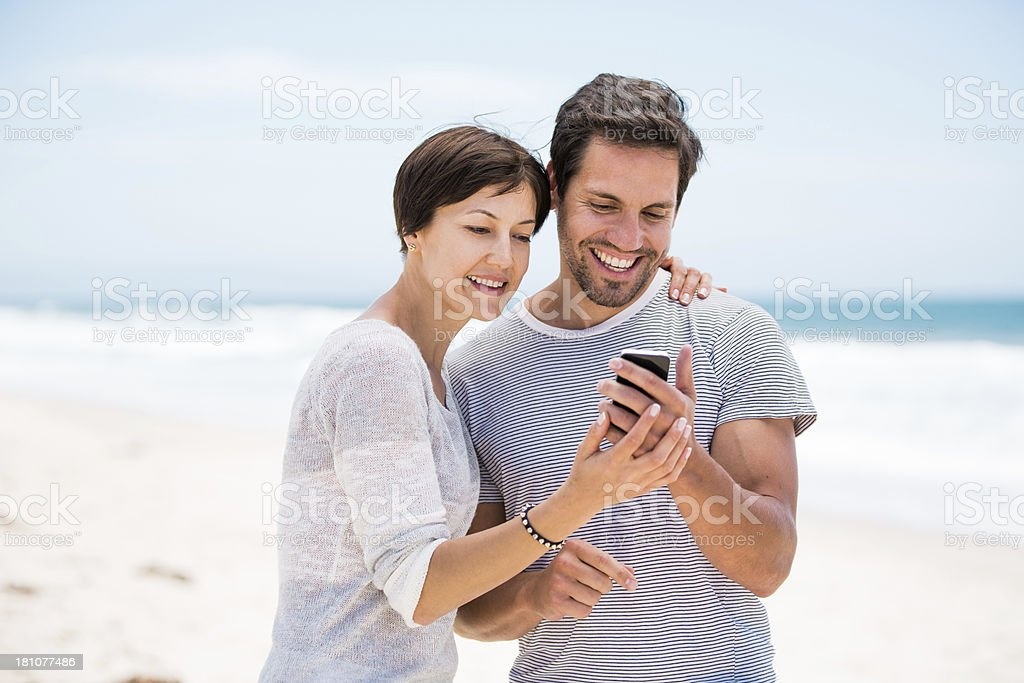 Couple using a cell phone royalty-free stock photo