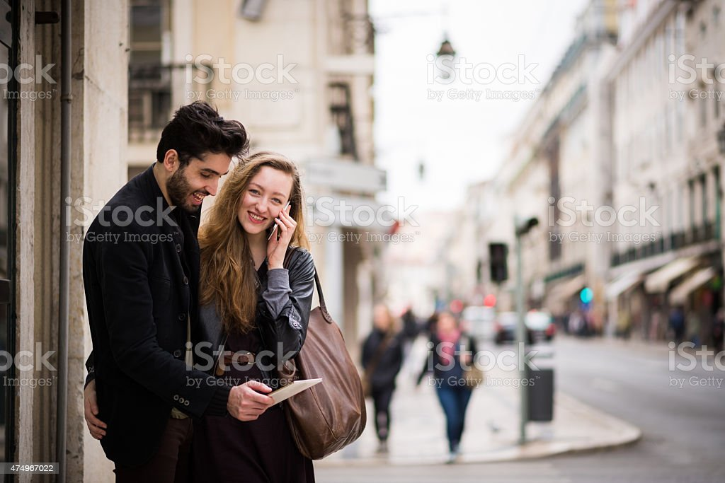 Couple using a digital tablet and smart phone