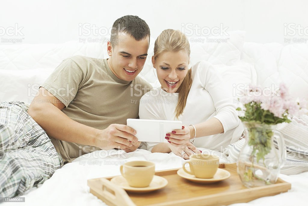 Couple using a digital tablet at home royalty-free stock photo