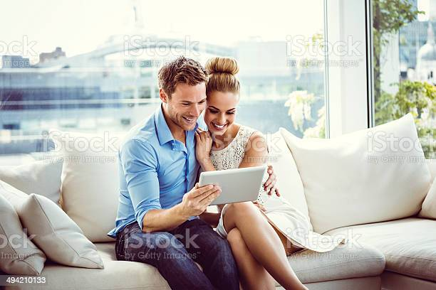 Couple Using A Digital Tablet Stock Photo - Download Image Now