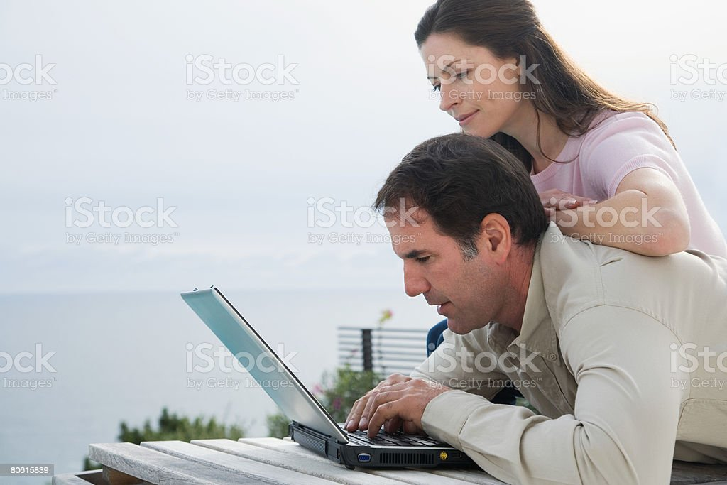 A couple using a laptop royalty-free stock photo