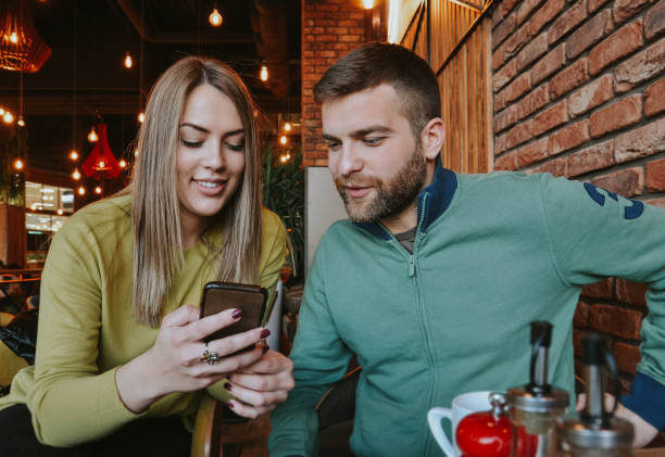 Couple using a smartphone stock photo