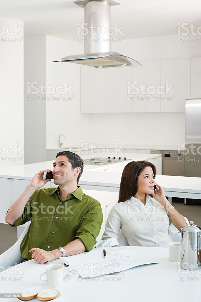 Couple using cellular telephones 免版稅 stock photo