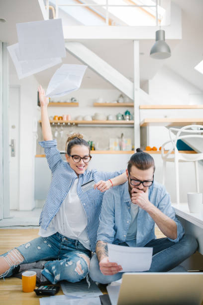 Couple using credit card stock photo