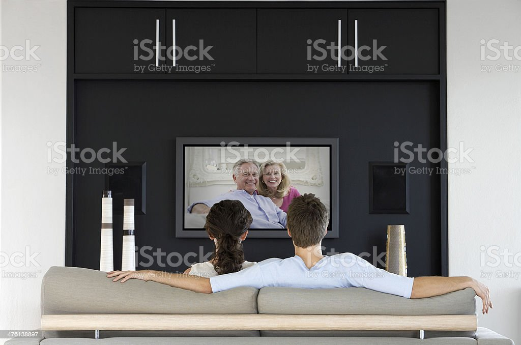Couple using internet Webcam on their Television stock photo