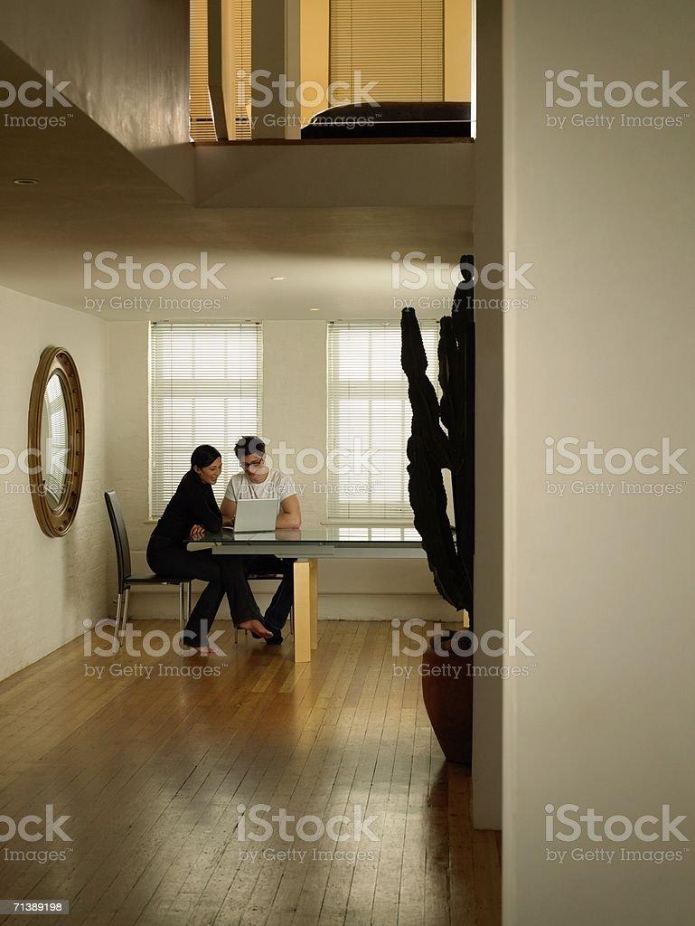 Couple using laptop computer royalty-free stock photo