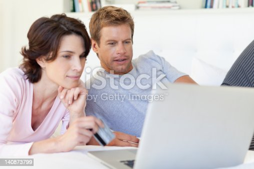 istock Couple using laptop together 140873799