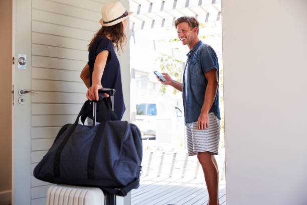 Couple Using Online App To Book Cab For Vacation stock photo