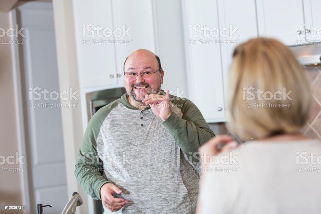 Couple using sign language stock photo