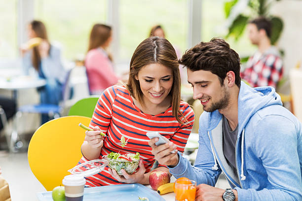 Couple using smart phone in cafeteria picture id466306782?b=1&k=6&m=466306782&s=612x612&w=0&h=unc oh zskus1dy pldg9dulcbg8jk0es whqje6diw=