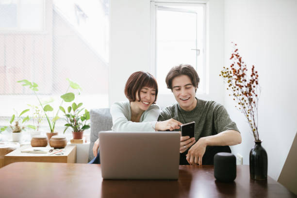 Couple Using Technology Together stock photo