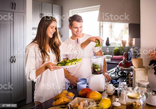 Couple using their blender to make a healthy breakfast picture id471881502?b=1&k=6&m=471881502&s=612x612&h=muuk9 q tqusbcpyne8iseqc5ckdlxvescwx7kdwa8q=