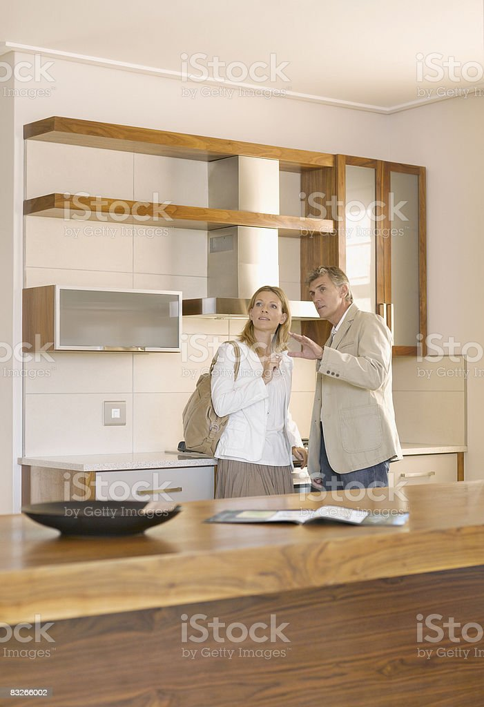 Couple viewing interior design showroom royalty free stockfoto