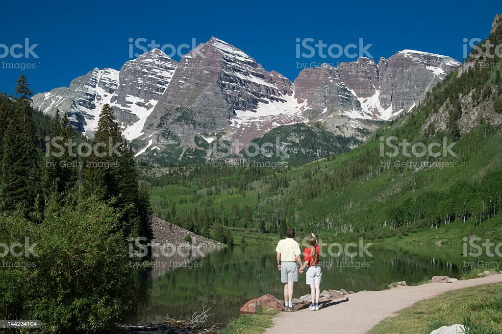 Couple viewing Maroon Bells stock photo