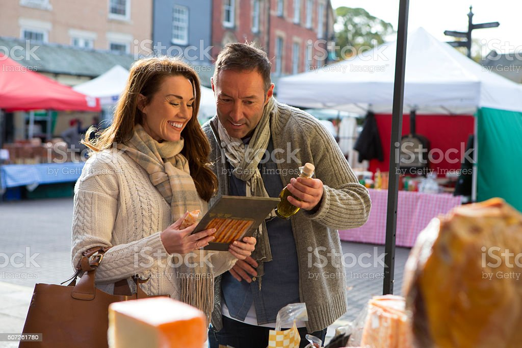 Couple Visit Local Food Market stock photo