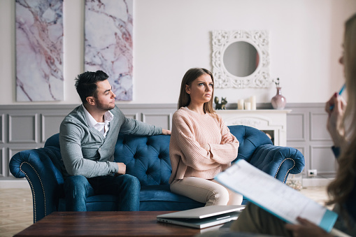 Couple Visiting A Psychologist And Having A Psychological Session While Dealing With Problems In Relationships Stock Photo - Download Image Now