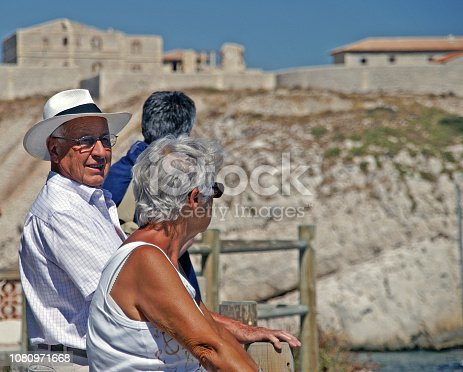 istock Couple visiting an old architecture 1080971668