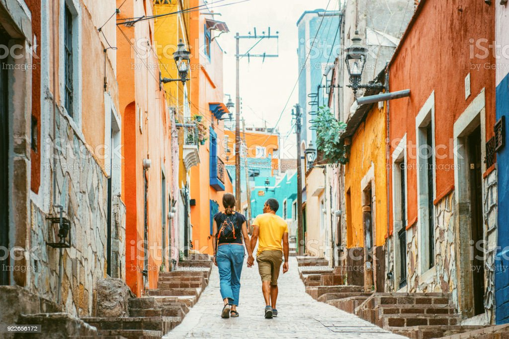Couple visiting Guanajuato Mexico Couple walking the colorful narrow streets of Guanajuato in Mexico 30-39 Years Stock Photo